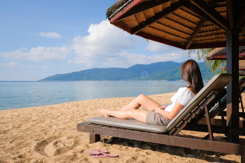 Relaxing image of beautiful girl at holiday island. Beautiful young asian woman leisure around the beach sea and ocean with blue sky for vacation travel image stock photos