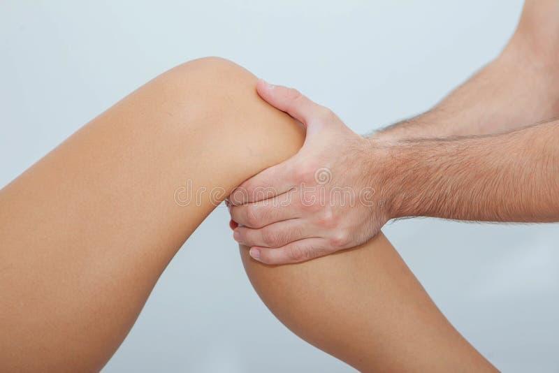Relaxing leg massage stock images