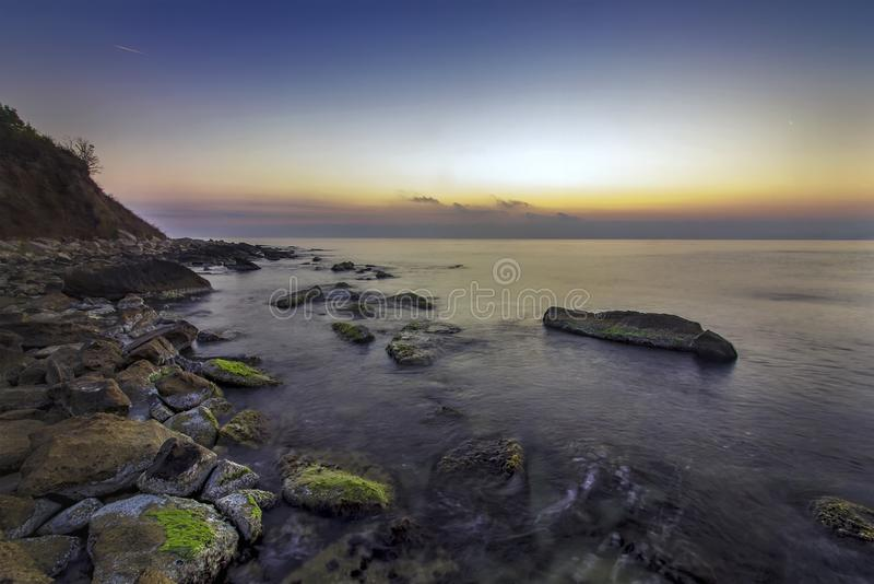 Relaxing long exposure seascape of rocky coast stock photo