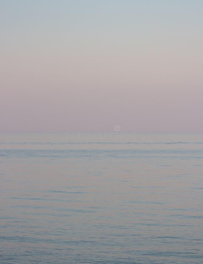 Minimalistic photograph of a lake at sunset royalty free stock image