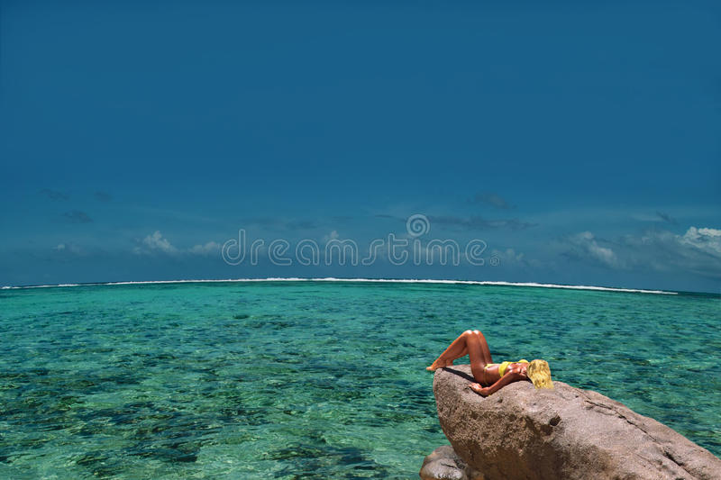 Download Relaxing Model On Lagoon Rock. Top & Endless. Stock Photo - Image: 16208728