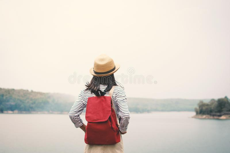 Relaxing moment Asian girl backpacker in nature. Enjoying time on holiday concept ,color of vintage tone selective and soft focus stock images