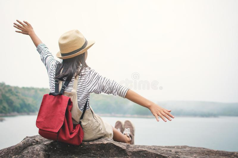 Relaxing moment Asian girl backpacker in nature. Enjoying time on holiday concept ,color of vintage tone selective and soft focus stock photos