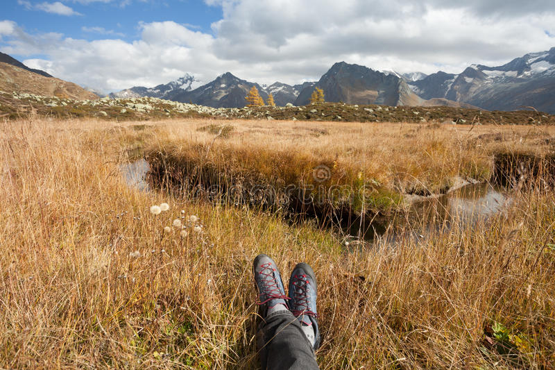 Relaxing next to the mountain stream royalty free stock image