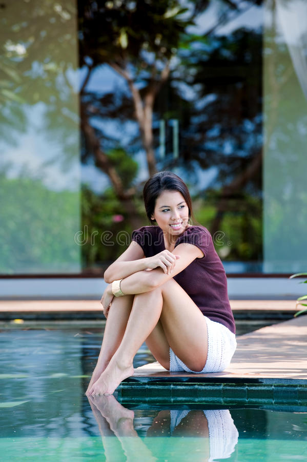 Relaxing By Pool Royalty Free Stock Images