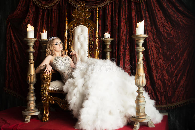 Relaxing queen on the throne. Joy, pleasure. Royal. Relaxing queen on the throne. Joy, pleasure royalty free stock photography