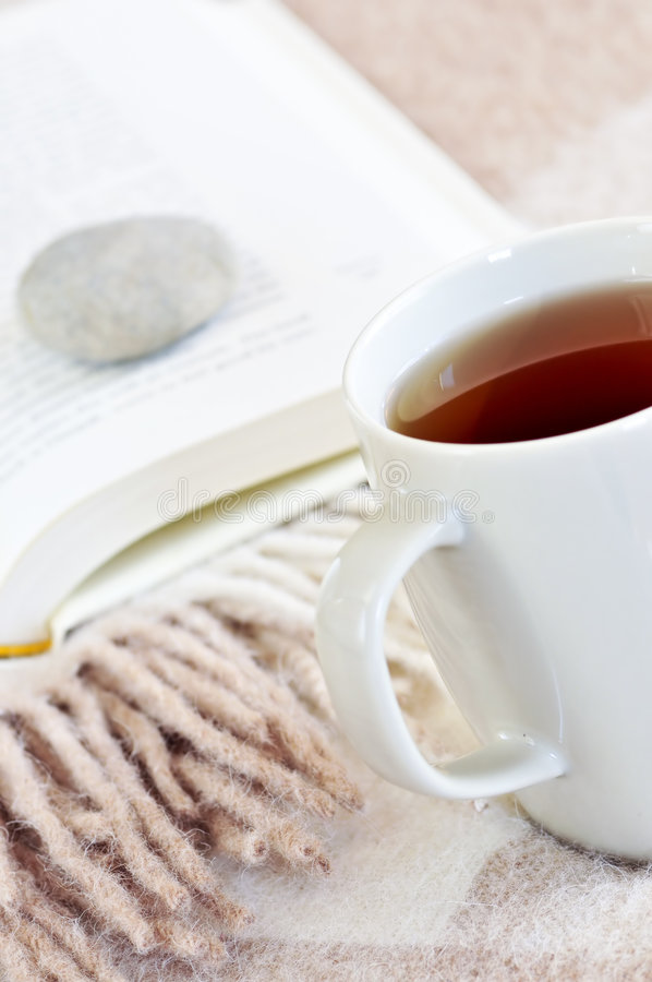 Relaxing reading with tea stock images