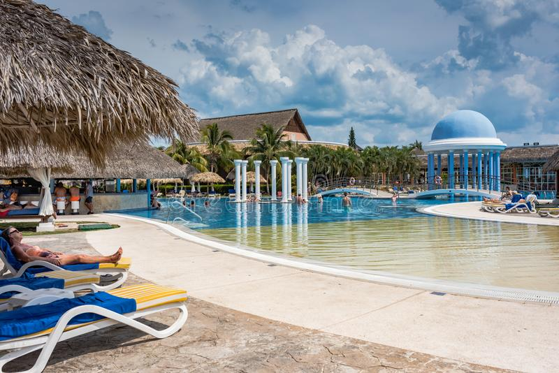 Relaxing at the Resort Pool. Varadero, Cuba / March 19, 2016:, 2016: Guests playing in and relaxing by the resort pool stock image