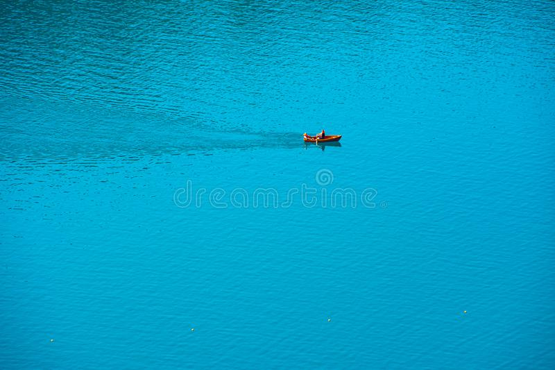 Relaxing rinde with a Boat on water. On lake Bled royalty free stock photography