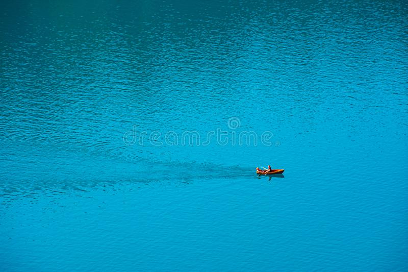 Relaxing rinde with a Boat on water. On lake Bled royalty free stock photo