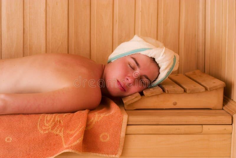 Relaxing in sauna stock image
