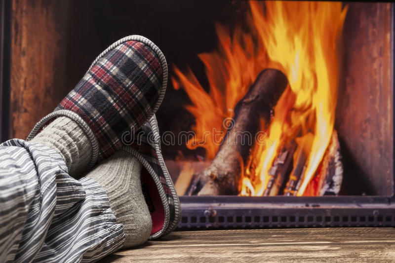 Relaxing in slippers at fireplace stock photos