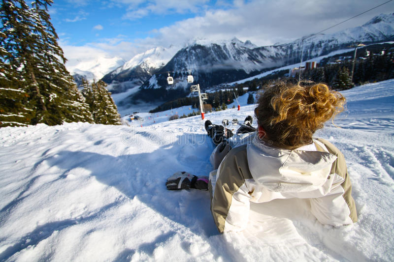 Relaxing on Snow Beach. Woman Relaxing and Sunbathing on a ski slope stock image