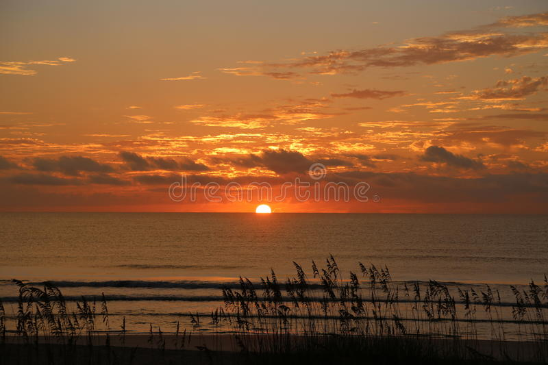 Relaxing Sunrise. A nice calm and relaxing sunrise at the beach stock image