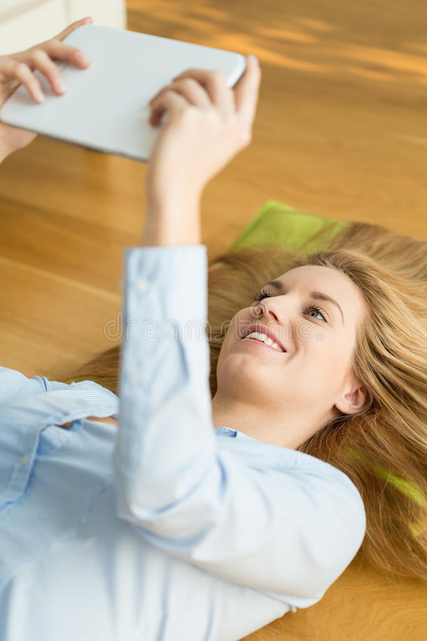 Relaxing with tablet stock photography