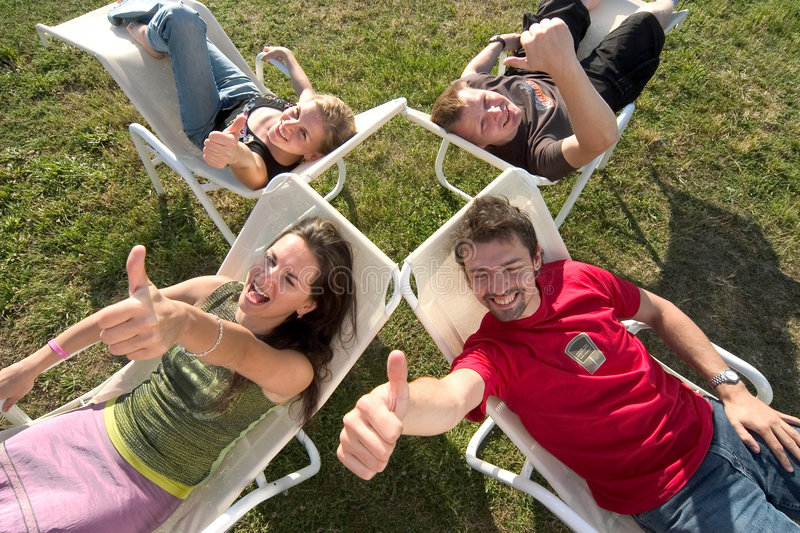 Relaxing with thumbs up stock photos