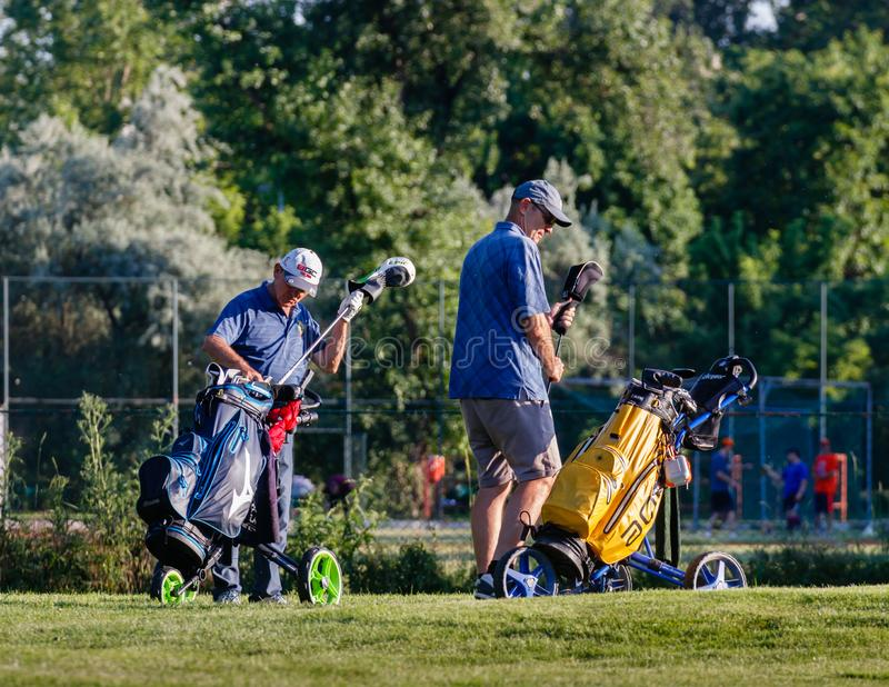 Belgrade, Serbia -June 1, 2019: senior golfers preparing the equipment for the tour stock images