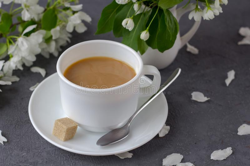 Relaxing time and happiness with cup of coffee with among fresh spring flower. stock image