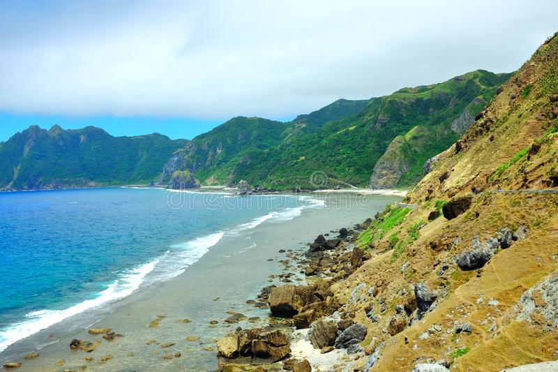 Tropical coastline at summer in the Philippines. Relaxing tropical coastline at summer in Chavayan, Sabtang Island, Batanes, Philippines royalty free stock photos
