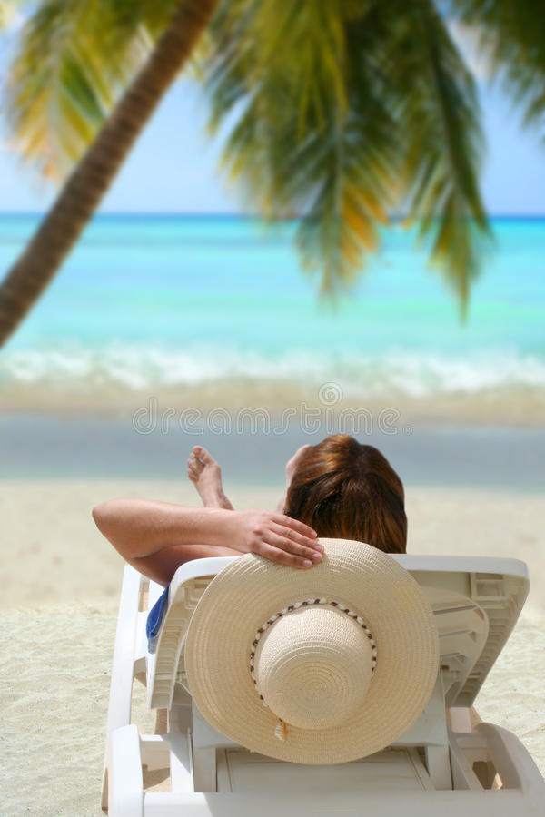 Relaxing tropical woman stock photography