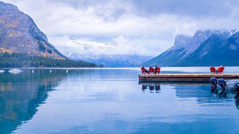 Relaxing visitors at Lake Minnewanka during autumn , Banff National park. Alberta, Canada stock photo