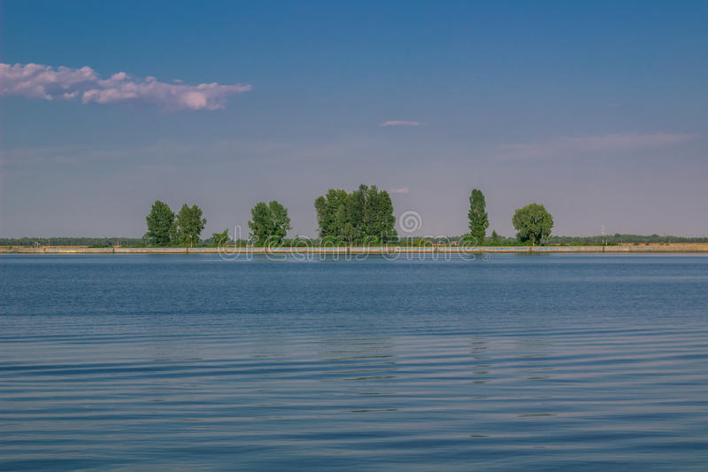 Relaxing water landscape with tree reflections in lake. Relaxing water landscape with tree reflections stock photography