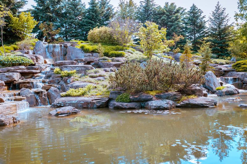 Relaxing waterfall in Grand Rapids Michigan at the Frederik Meijer Gardens. On a sunny spring day royalty free stock images