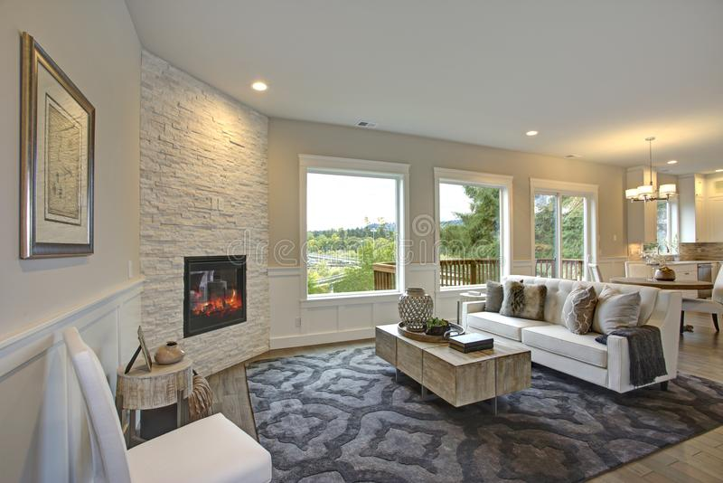 Luxury living room features corner stone fireplace stock image