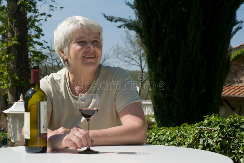 Relaxing with wine stock photo