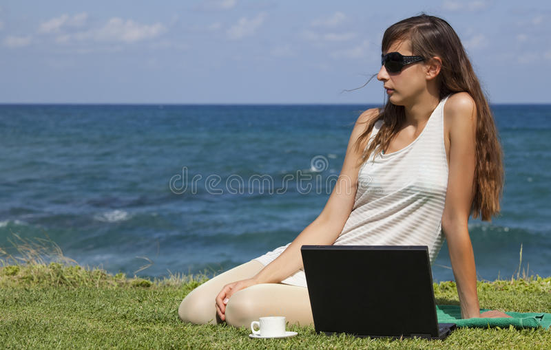 Relaxing woman with laptop royalty free stock photos