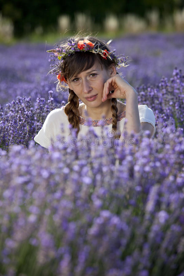 Relaxing woman in lavender field royalty free stock photos