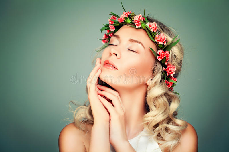 Relaxing Woman Spa Model with Flowers. On Green Background royalty free stock photos