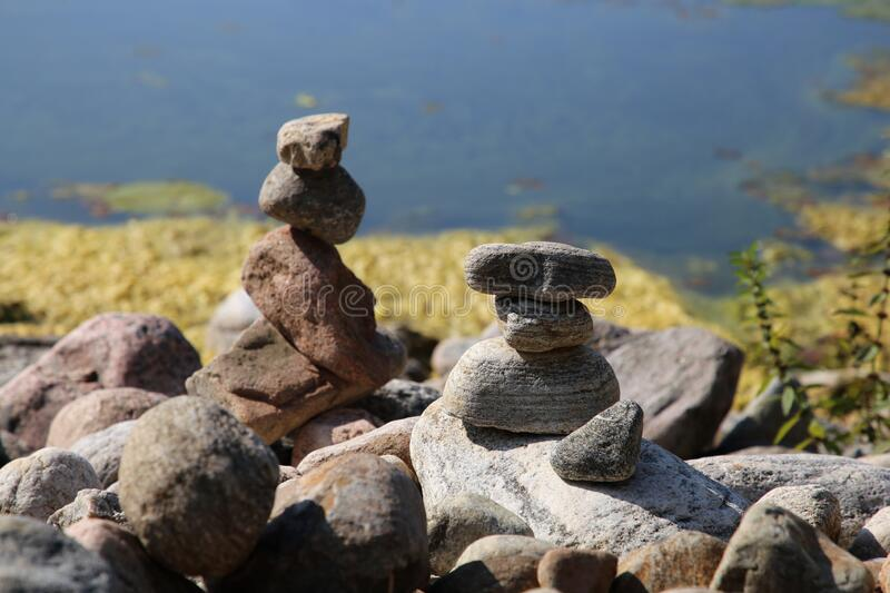 Relaxing, Zen Like View Including Stacks of Natural Rocks and a Lake during a Sunny Day royalty free stock photo