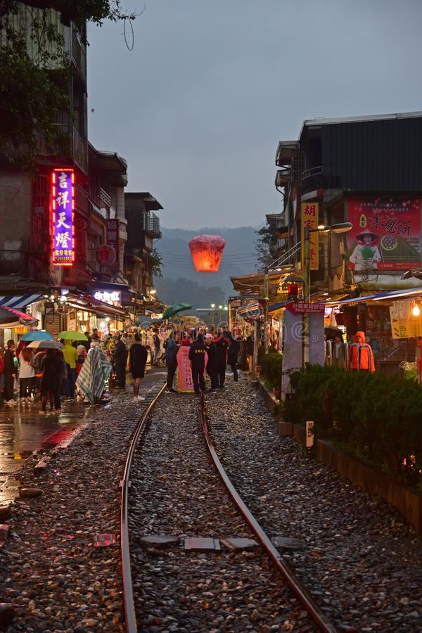 Free Releasing Lantern Into The Sky While Holding Umbreall On A Rainy Day At Shifen Old Streets In The Late Evening Royalty Free Stock Photo - 126039015