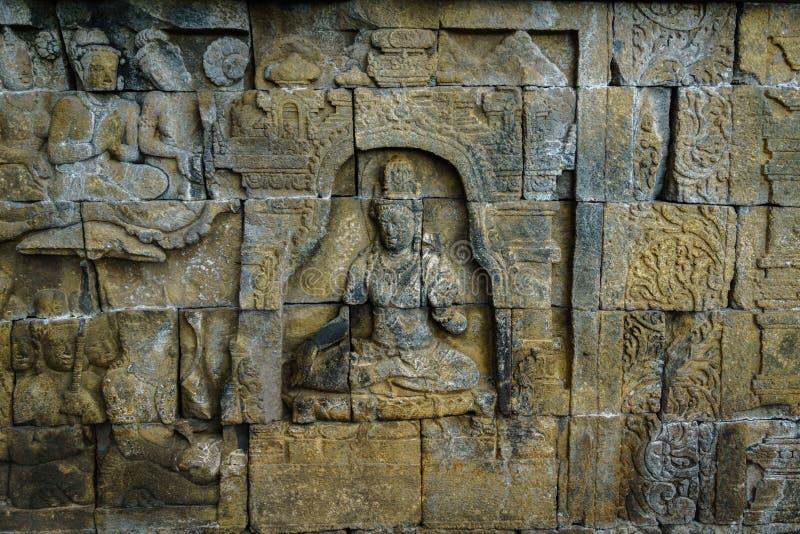 Relevo cinzelado no templo de Borobudur em Java Indonesia fotos de stock royalty free
