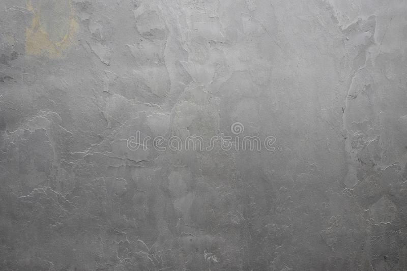 Relevo cinzento natural da textura do estuque A parede ? feita do concreto, a superf?cie textured fotografia de stock royalty free