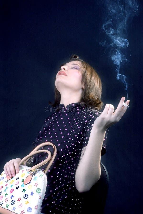 Download Relevo de esforço foto de stock. Imagem de fumar, fêmea - 543652