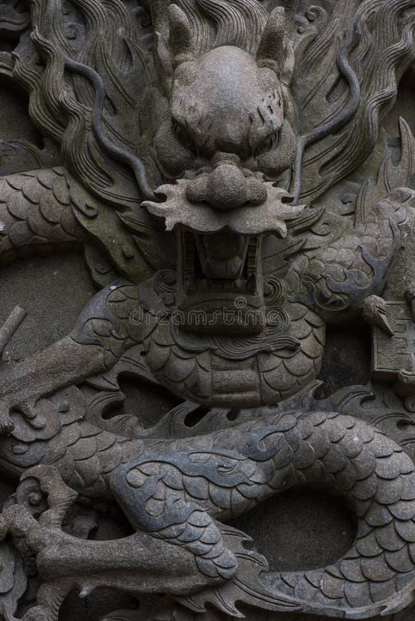 In reliëf gemaakte Draak stock afbeeldingen