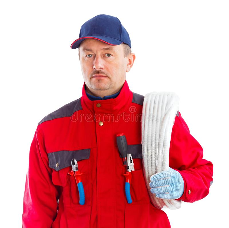 Reliable Electrician. Handsome electrician with a flexible tube roll on his shoulder stock photography