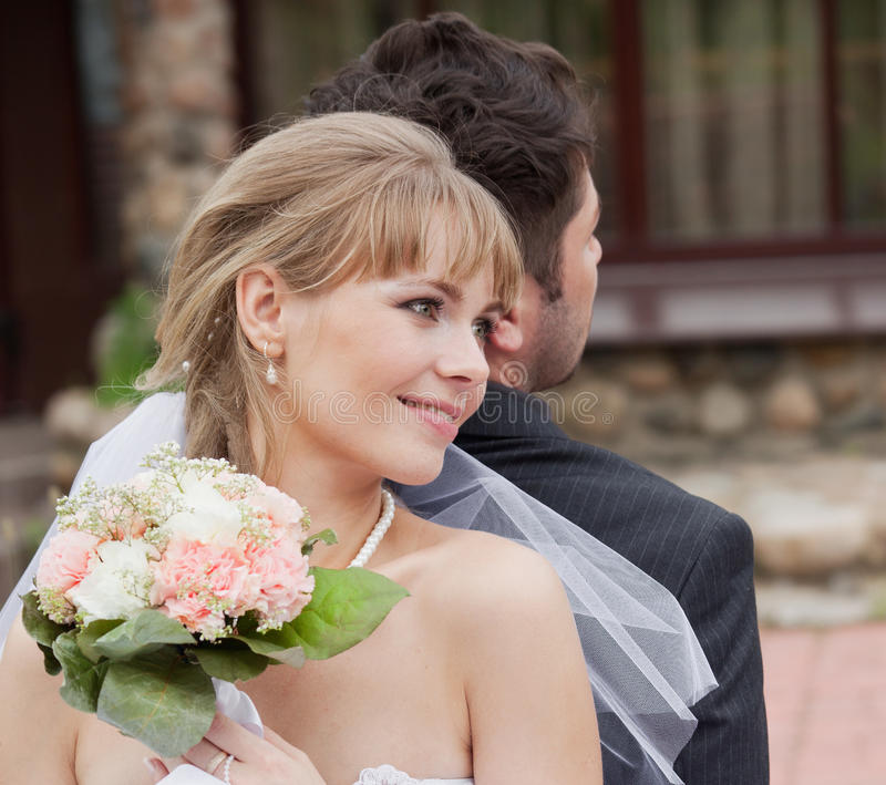 Reliable shoulder. The head of the bride leans on a shoulder of the groom royalty free stock image