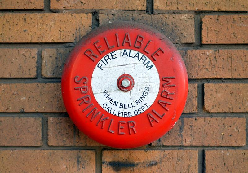 Reliable Sprinkler Fire Alarm Bell on a Brick Wall. Bracknell, England - February 21, 2018: A Reliable Sprinkler Alarm Fire Alarm Bell on an external brick wall stock photo