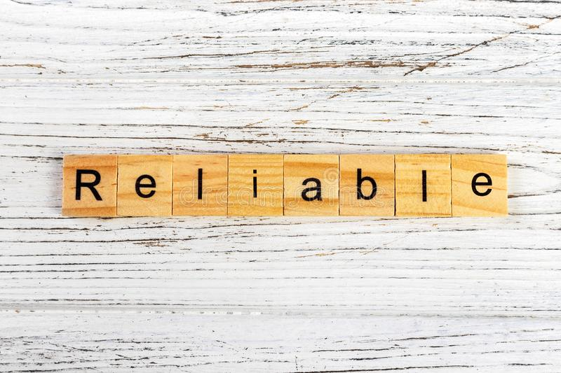 RELIABLE word made with wooden blocks concept.  stock photography