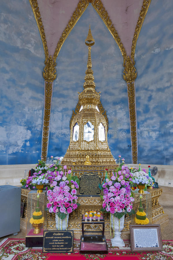 Relics of Buddha enshrined on the topmost floor inside Phra Maha Chedi Chai Mongkol, Roi Et province, northeastern Thailand. Small stupa containing relics of stock photo
