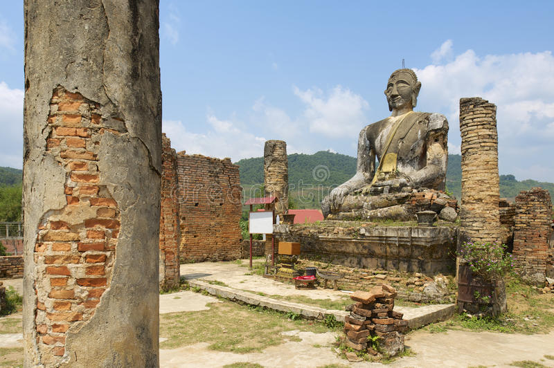Relics of Wat Piyawat temple, Xiangkhouang province, Laos. This Buddha image is the only one in Phonsavan area, which survived US carpet bombings of Laos royalty free stock photo