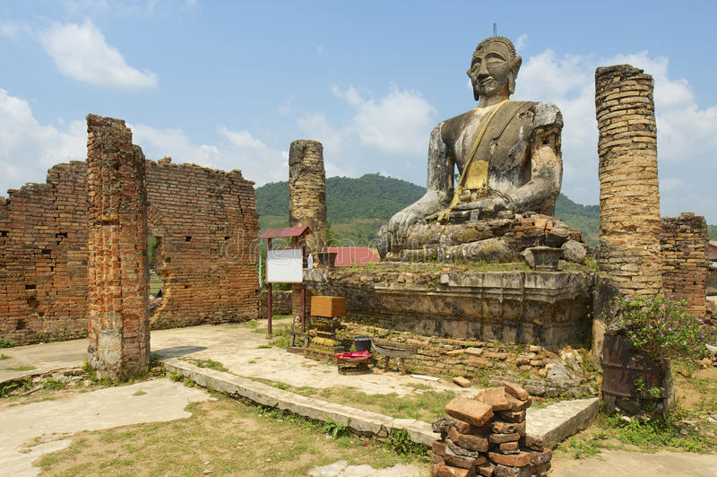 Relics of Wat Piyawat temple, Xiangkhouang province, Laos. This Buddha image is the only one in Phonsavan area, which survived US carpet bombings of Laos royalty free stock photos