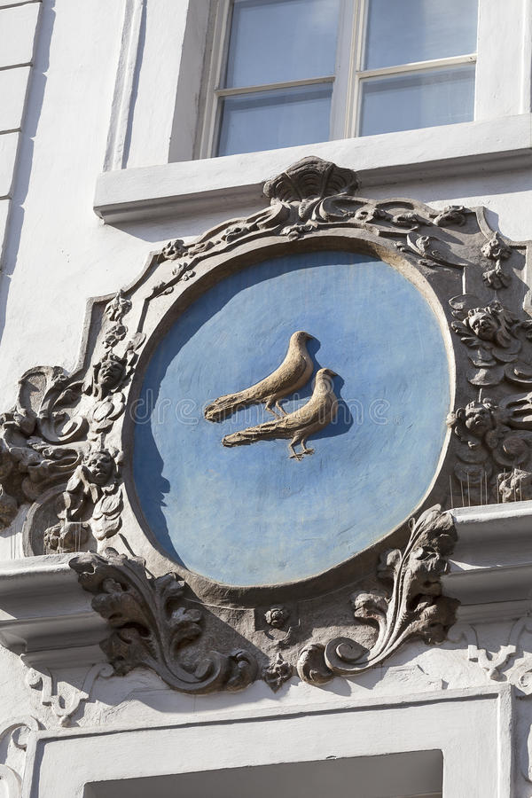 Relief on facade of old building, birds, Nerudova street, Prague, Czech Republic royalty free stock images