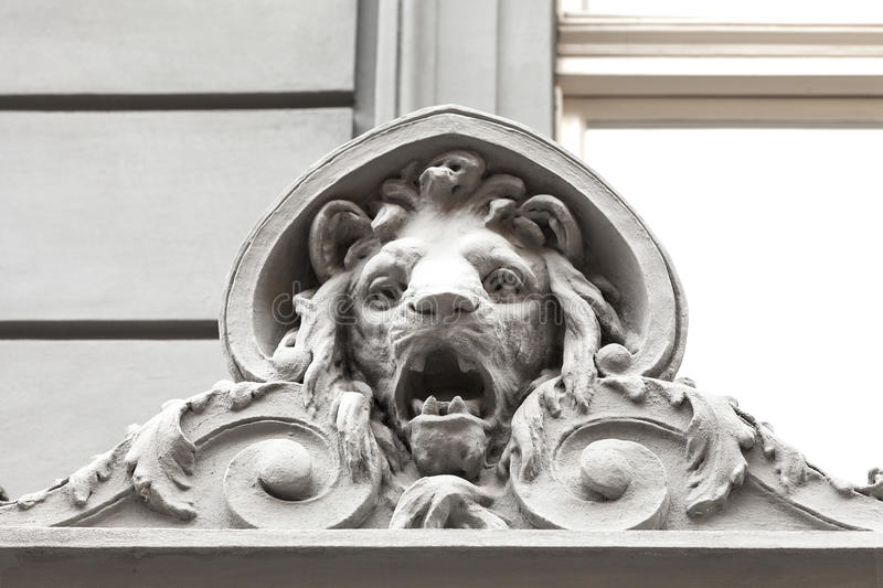 Relief on facade of old building, stone lion, Prague, Czech Republic royalty free stock photos