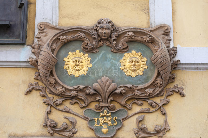 Relief on facade of old building,two suns, Nerudova street, Prague, Czech Republic royalty free stock photo