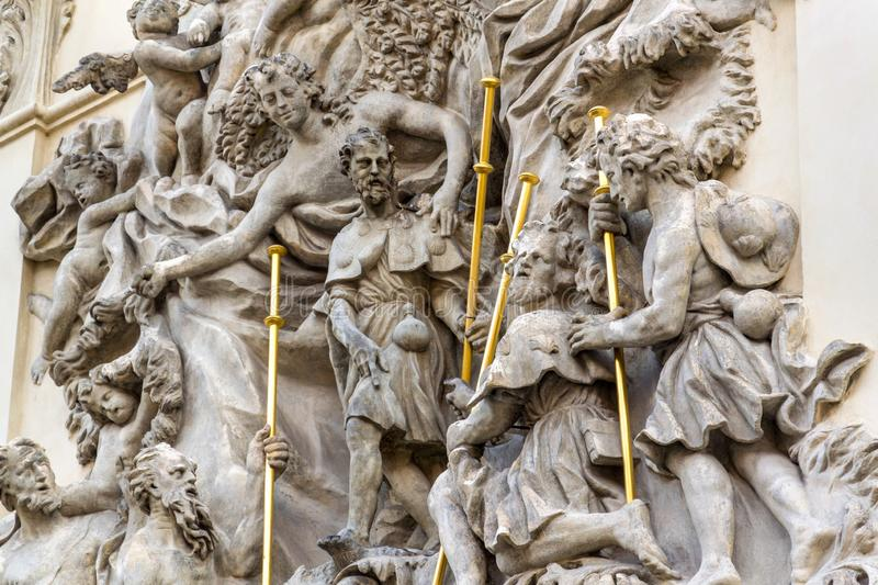 Relief sculpture on facade of the Church of Saint James The Greater with Minorite monastery in Old Town of Prague, Czech Republic. Sunny day stock photo