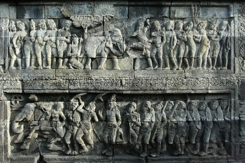Borobudur Relief Story. Relief sculptures in Borobudur temple which tells about the life of society in ancient times royalty free stock image